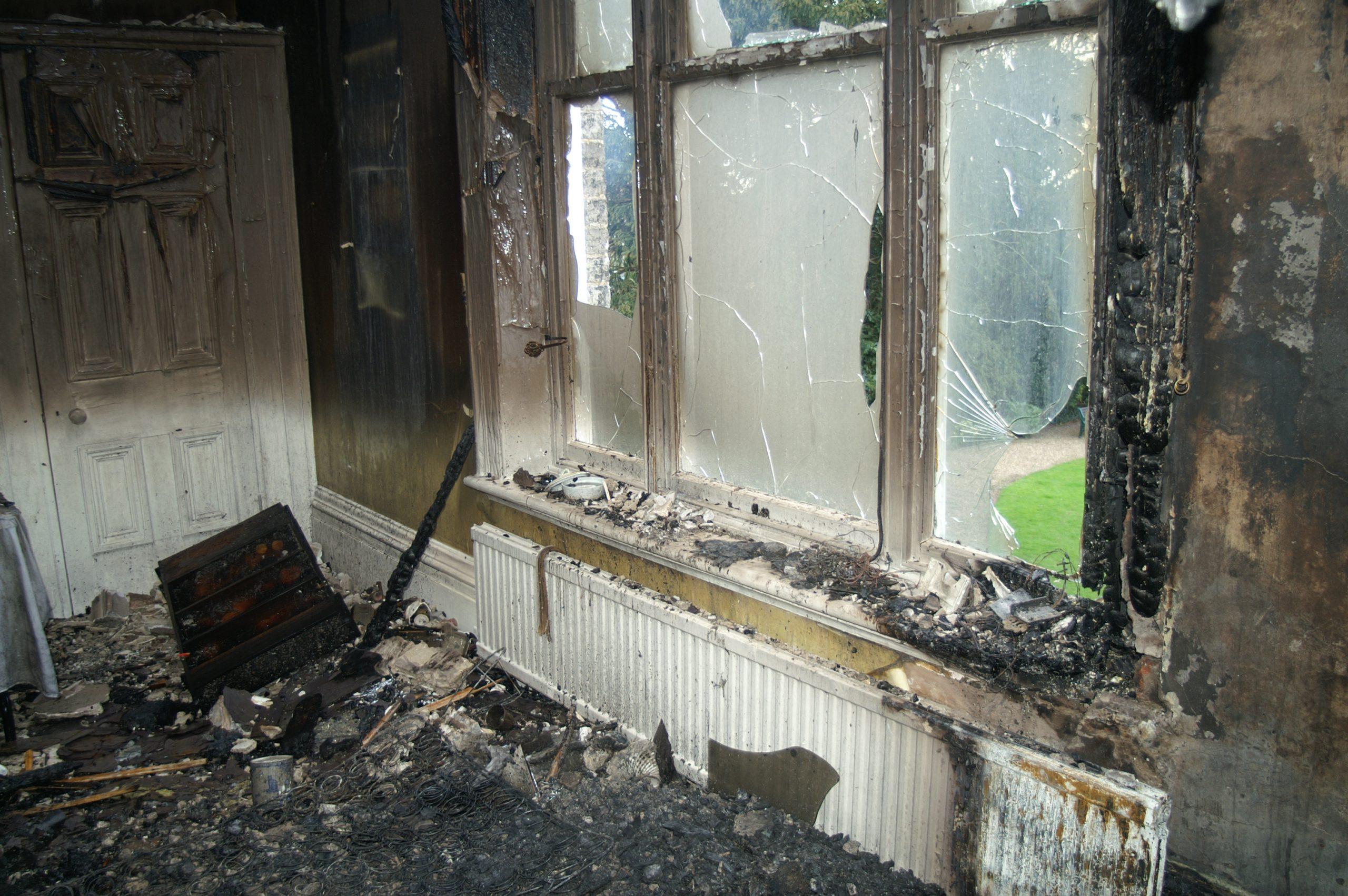 fire damaged living room – Regency Disaster Response Team